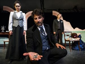 Actor holding out hand in The Cherry Orchard