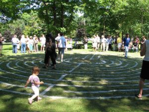 Children playing by the labyrinth